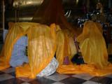 People Praying at the feet of the Buddha at Wat Phananchoeng