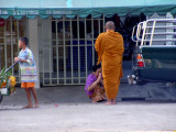 Monk Collecting his Morning Alms in Putham Thani