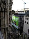 Gargoyles and figures facing department store .. B0778
