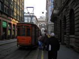 Boarding tram on Via Grossi .. 1674