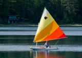 z P1080693 Sailboat nears shore in Lake McDonald.jpg