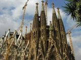 continual growth --Spires and cranes at La Sagrada Familia stand tall over the city of Barcelona