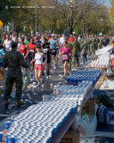 Runners Pass a Water Station
