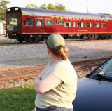 Carmon watches the OCS roll by