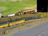 Espee commute train powered by a Fairbanks-Morse H24-66 Train Master (Atlas model) passes the UP Gas Turbine set (new from Athearn)
