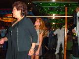 Gina walking under the limbo pole