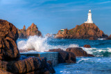 Surf and lighthouse, La Corbiere