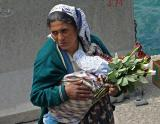 The rose seller with her baby