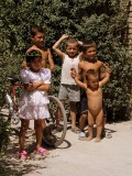 Local Uzbek kids outside Rishton Pottery Factory