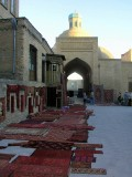Bukhara - a sea of red carpets lights up an evening stroll