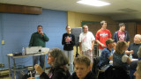 Helpers with the MC for St. Augustine's first annual trivia contest