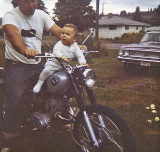 Jason Riding 1966 Honda 160cc Motorcycle ( Ford Failane In Backdrop