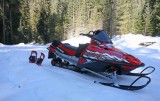 Tools To WInter Paradise ( Snowmobile And Snowshoes Strapped On Back )