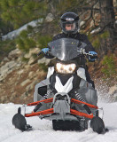 Young Lady Enjoying Late Winter Snowmobiling On Upper Entiat Road