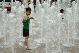 Boys cooling off in fountains, Seoul