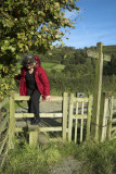 Climbing a stile on the Cotswold Way