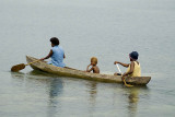 Family in a dugout canoe