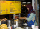 Muslim woman cooking roti