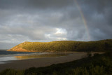 Late afternoon rainbow over Norman Bay