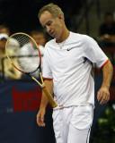 Mac throws his racquet