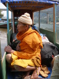 A Buddhist monk waiting for the boat to leave