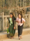 Local girls on bridge in late afternoon