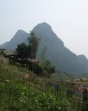 Washing and crops on riverbank, Muang Ngoi