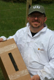 Me, holding up the nuke, a box full of bees including a queen.