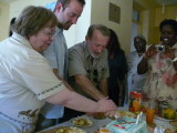 It is tradition in East Africa for the birthday guy to cut the cake along with his parents
