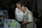 Lynda, Jim & the anniversary cake at the Pinto's Welcome Reception