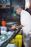 One of the fish mongers preparing his products