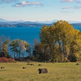 Hay Rolls, Lake Champlain, and the Green Mountains