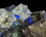Fluorite twin (with complex corner modifications), 5 mm, with azurite and malachite, Great Sled Dale Mine, N Yorkshire.