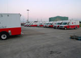 RED CROSS EMERGENCY VEHICLES, LINED UP AND READY TO GO