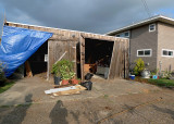 THE GARAGE HAD BEEN COMPLETELY FLOODED AND PUSHED OFF ITS FOUNDATION