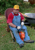 A WHEELBARROW MAKES A NICE SEAT FOR SHARPENING THE CHAIN!