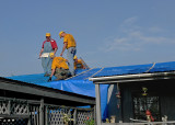 INSTALLING A FULL-ROOF COVERING WITH A TEMPORARY TARP