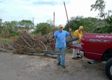 THE ROAD CREW, ARRANGING THE DEBRIS PILES AND KEEPING THE MAIN ROAD CLEAR