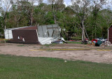 A METAL STORAGE BUILDING, MADE SOMEWHAT WORSE FOR THE WEAR BY HURRICANE IKE