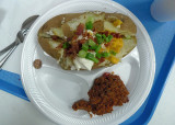 THE FEEDING LADIES GAVE ME A TEXAS POTATO!  - (THE PENNY ON THE PLATE HELPS SHOW ACTUAL SIZE)