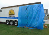 THE PROBLEM HAVING BEEN PROPERLY ASSESSED, OUT CAME THE UBIQUITOUS BLUE TARP