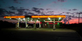 EVEN A MUNDANE GAS STATION LOOKS GOOD IN FRONT OF A SUNSET LIKE THAT!