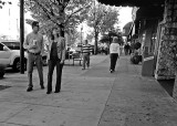 TOURISTS ON HENDERSONVILLE'S MAIN STREET - CAMERA HELD AT WAIST LEVEL, WHILE WALKING