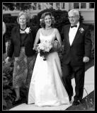 Happy Bride Escorted by Mom and Dad