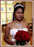A Pensive Bride, Her Jewelry, Gown and Flowers
