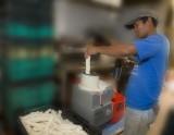 Romeo grinding cassava.psd