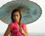 Blue Umbrella At Sunset