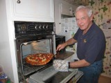 Pulling the 8 3/4 pound pizza from the oven - 12/31/2008