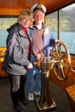 At the helm of the TSS Earnslaw