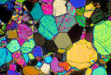 Photomicrograph of peridotite in thin section X10